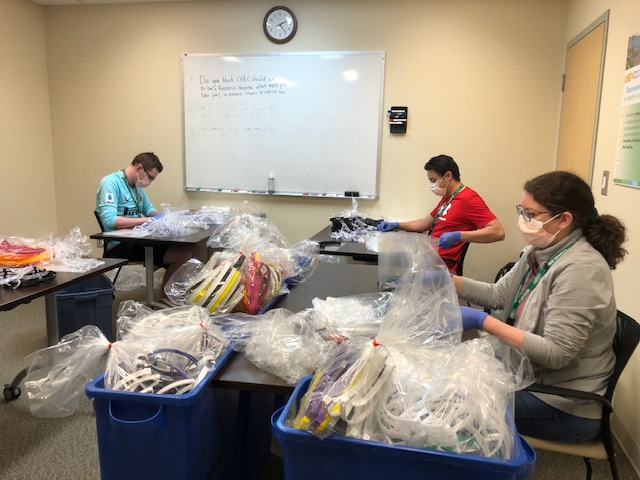 Assembling face shields for the Children's Hospital of Eastern Ontario during the COVID-19 pandemic.